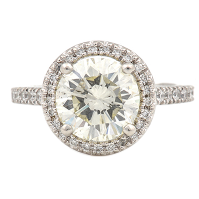 custom designed engagement ring with a diamond in a halo setting