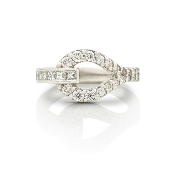 buckle ring with channel set and grain set diamonds