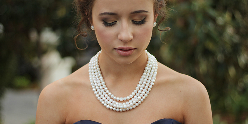 woman wearing pearls