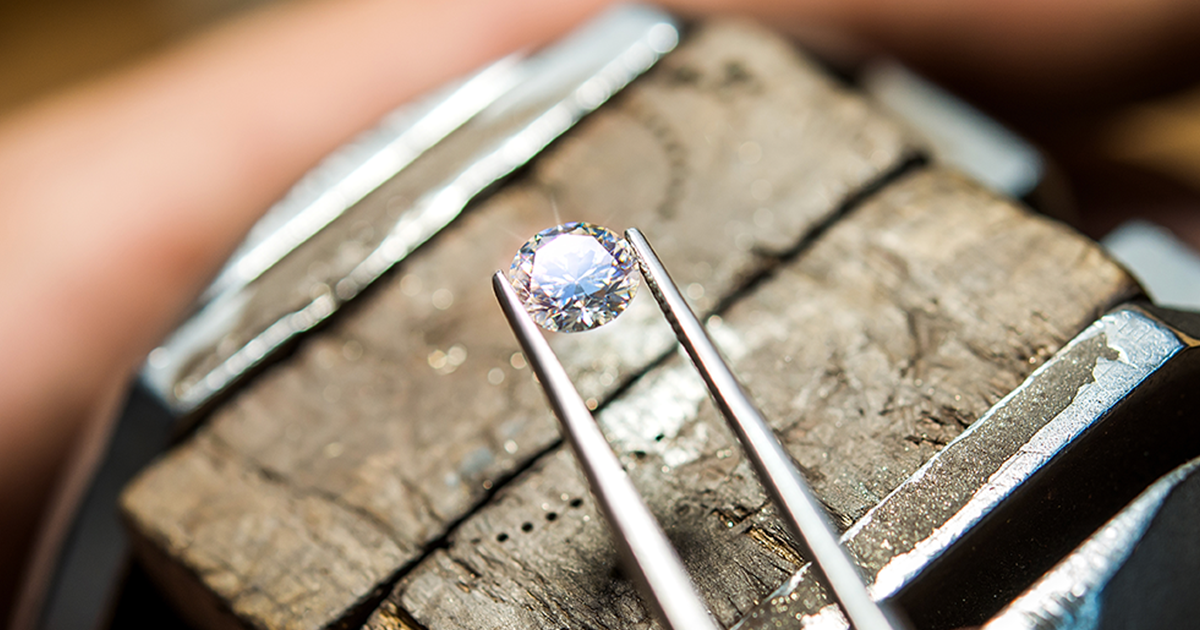 diamond on jeweller's bench